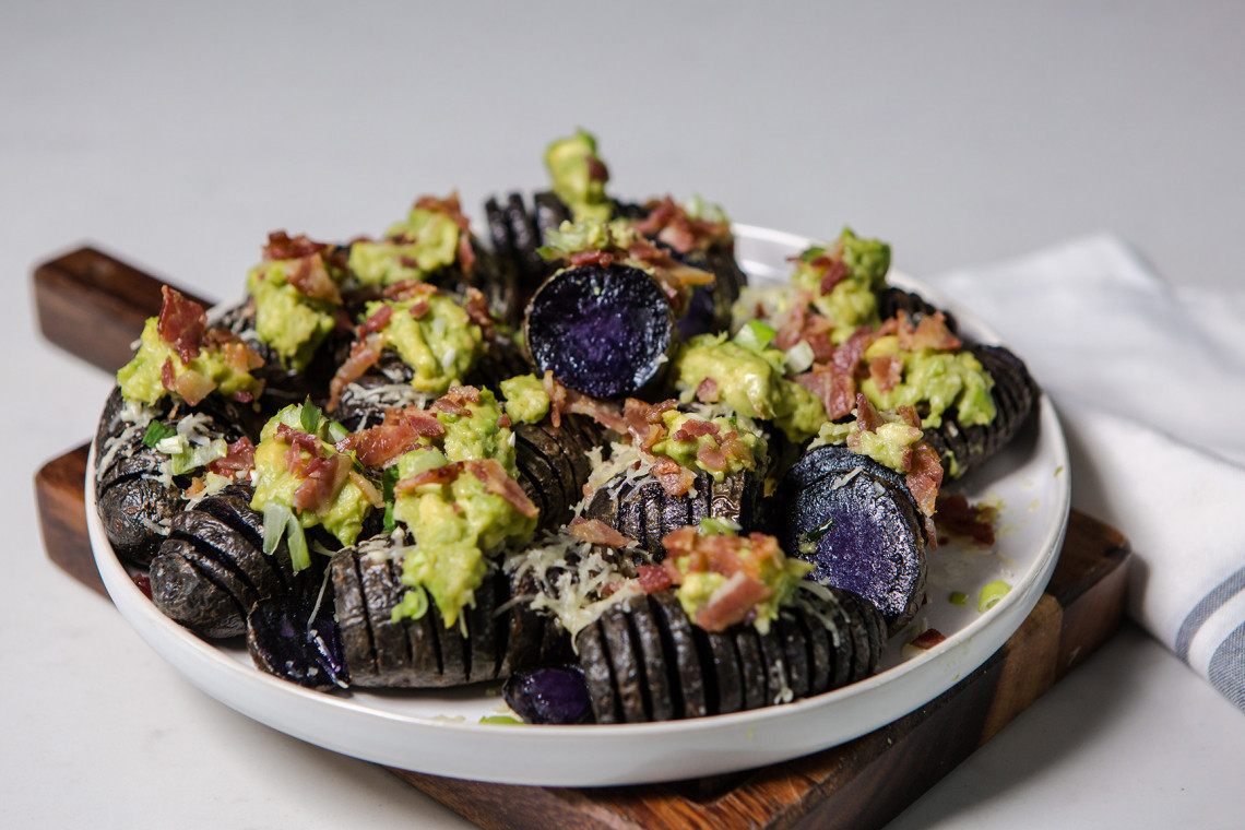 Violet Queen loaded Hasselback potatoes with smashed avocado and bacon