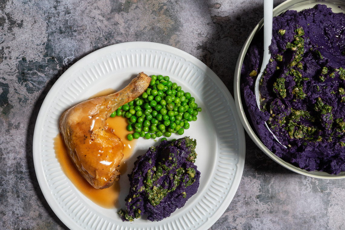 Violet Queen mashed potato with salsa verde, served with roast chicken and peas