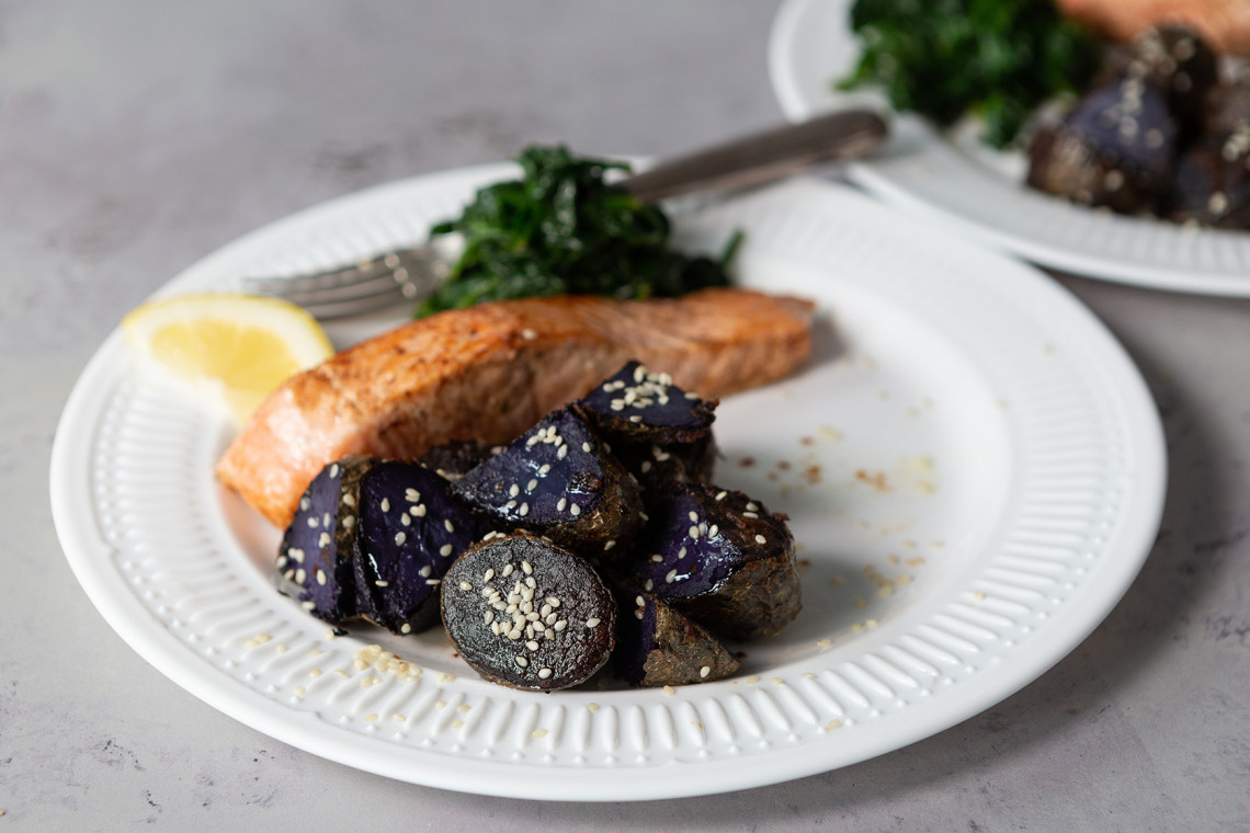 Roasted Violet Queen potatoes with miso, pan-fried salmon and spinach