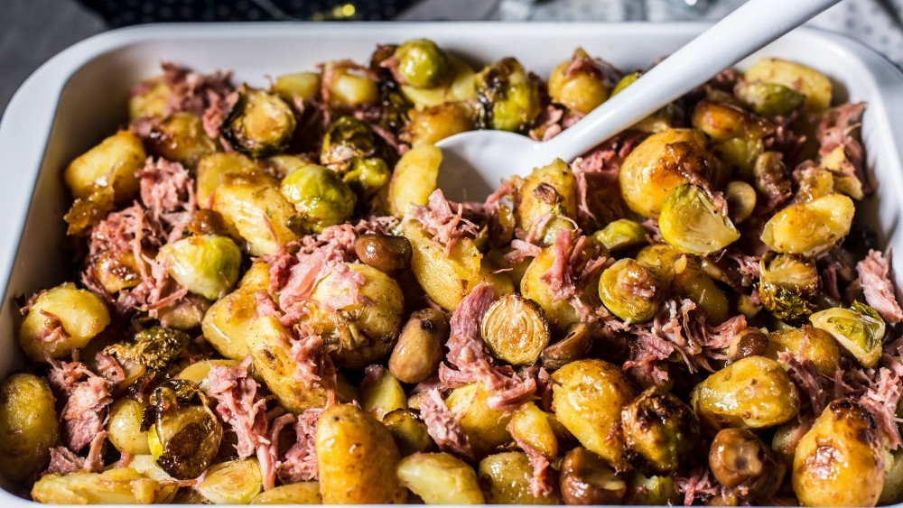 Potato, Brussel sprout and shredded ham tray bake with chestnuts