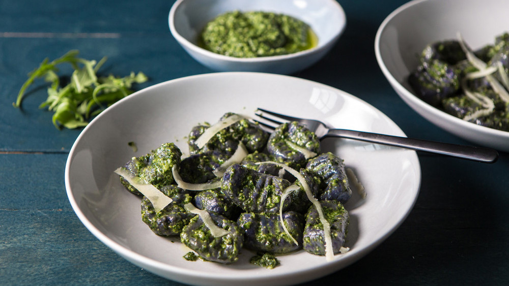 Purple potato gnocchi with rocket and basil pesto