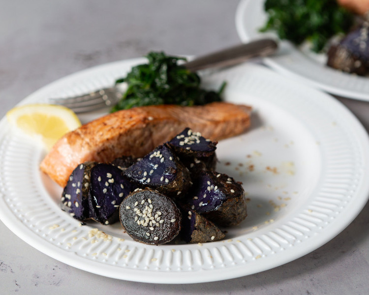 Roasted purple potatoes with miso, pan-fried salmon and spinach